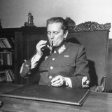 Marshal Tito Seated at His Desk Smoking Photographic Print