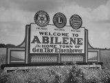 Highway Sign Welcoming Tourists to the Home Town of General Dwight D. Eisenhower Premium-Fotodruck von Myron Davis