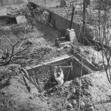 George Phillips, Ex-Army Lieutenant, Digging in the Bomb Shelter He Is Building in His Back Yard Photographic Print by Loomis Dean