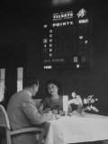 Couple Dining at the Sky Room Where Bets Can Be Placed and Played Premium Photographic Print