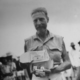 Freed American Pow Holding Red Cross Supplies after His Release from a Japanese Prison Camp Photographic Print by Carl Mydans