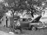 Man Camping Alongside Highway 30 Premium Photographic Print by Allan Grant