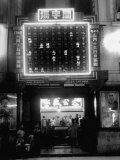 Exterior of Gambling Hall with Illuminated Board Flashing Winning Numbers Premium Photographic Print