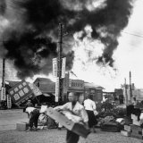 Scenes of Ruin, People Fleeing, Buildings Burning, as a Result of an Earthquake Disaster Photographic Print by Carl Mydans