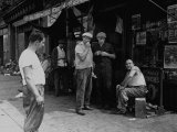 Men Sitting and Standing Outside of Shops Along Brooklyn Waterfront Premium Photographic Print by Alfred Eisenstaedt