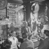 Man Reading About Election Straw Votes at Harry's New York Bar Photographic Print by Yale Joel