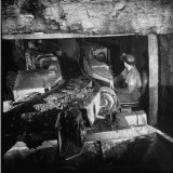 Machine Digging into Wall of Coal Mine Photographic Print