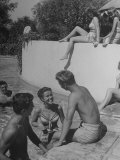 Young People Enjoying the Swimming Pool at Home of Herbert Stothart Premium Photographic Print by Nina Leen