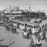 Heavily Loaded Rickshaws, Pedicabs, Streetcars and Trucks Crowd the Streets Photographic Print
