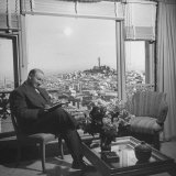 Chef George Mardikian, Reading a Book in His Apartment Photographic Print by Peter Stackpole