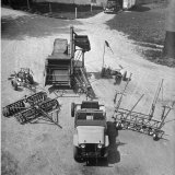Farm Equipment Surrounding a Farmer's Jeep in Demonstration of Postwar Uses for Military Vehicles Photographic Print by Myron Davis