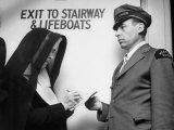 Western Union Messenger Delivering a Telegram to a Nun on Board Ship Who Is Signing for It Premium Photographic Print by Martha Holmes
