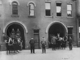 Firefighters Posing in Front of their Firehouse Premium Photographic Print by Allan Grant