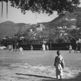 Cricket Club Members Engaging in Friendly Game of Lawn Tennis Photographic Print