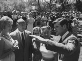 """Edward M. Kennedy Talking to People at the """"Key Women for Kennedy in California"""" Rally Premium Photographic Print by Ralph Crane"""