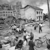 Scenes of Ruin, People Fleeing in Fukui, as a Result of an Earthquake Disaster Photographic Print by Carl Mydans