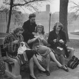Members of Ballet Russe Sitting in a Park Mending their Shoes and their Tights Photographic Print by Myron Davis