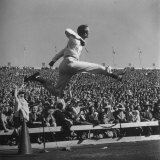 Smu Cheerleader Leaping High into Air at University of Texas Football Game Photographic Print by Loomis Dean