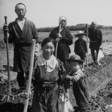 Postwar Japanese Farming Family Posing with their Tools in the Field Photographic Print by Carl Mydans