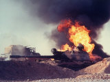 Iraqi Tank Burning While US Army Convoy Drives Past into Iraq During Gulf War Premium Photographic Print by Ken Jarecke