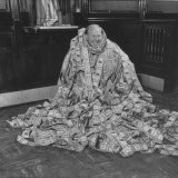S. Baxton Bryant Sitting Triumphantly Swathed in 2,670 Ft. of Bills Taped Together Photographic Print