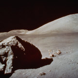 Apollo 17's Rover, a Lunar Vehicle, on the Surface of the Moon Next to Giant Rock Fotografiskt tryck