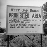 Sign on Roadside Near the Oak Ridge Nuclear Facility Declaring the Area Prohibited and Restricted Photographic Print by Ed Clark