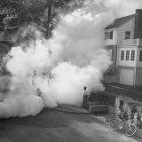 Children Playing in the Ddt Fog Left Behind by the Tifa Truck Photographic Print