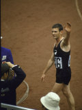 New Zealand Athlete Peter Snell Waving after He Wins the 1,500 Meter Race at the Summer Olympics Premium Photographic Print