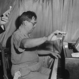 Composer Ernesto Lecuona Playing Piano for British Radio Program Photographic Print by Ed Clark