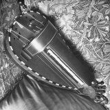 Musical Hurdy Gurdy Laying on the Couch Photographic Print