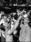 Men Having a Beer Drinking Contest at the Company Picnic Premium Photographic Print by Allan Grant