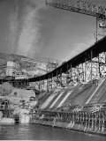 "The Grand Coulee Dam under Construction with a Sign in the Bkgrd. That Says: ""Safety Pays"" Premium Photographic Print by Alfred Eisenstaedt"