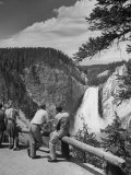 Tourists Viewing Waterfall in Yellowstone National Park Fotografisk tryk af Alfred Eisenstaedt