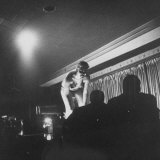 Woman Performing a Strip Tease Dance Photographic Print