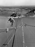 Man Working on the Texas Illinois Natural Gas Company's Pipeline Suspension Bridge Reproduction photographique sur papier de qualité par John Dominis