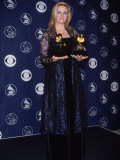 Country Singer Trisha Yearwood Holding Her Awards at the 40th Annual Grammy Awards Premium Photographic Print by Dave Allocca