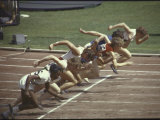 Women Sprinters in the 100 Meter Race at the Summer Olympics Premium Photographic Print