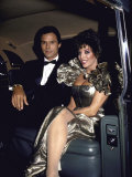 Actors Michael Nader and Joan Collins Sitting in a Car Kunst på  metal af John Paschal