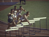Glenn Davis(F) in Action at the Summer Olympics During the 400 Meter Hurdles Which He Won Premium Photographic Print