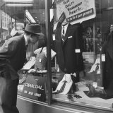 Man Shopping for Clothing Photographic Print by Nina Leen