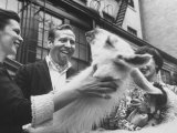 Skitch Henderson Laughing at a Llama During a Party Premium Photographic Print