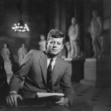 Senator John F. Kennedy Seated in Museum W. Statues Photographic Print