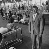 Gym Owner, Vic Tanny in One of His 60 Gyms Photographic Print by Allan Grant