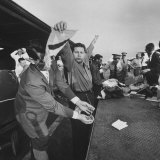 Cubans Being Searched by Customs Officials before Returning to Cuba Photographic Print