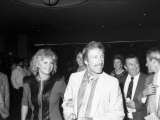 Actor Chuck Norris with Wife, Dianne Mingling at Tyson Spinks Pre-Fight Party, Trump Plaza Hotel Premium Photographic Print
