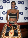 Model Tyra Banks Holding Cake with Her Likeness at Gq Magazine Party Premium Photographic Print by Sylvain Gaboury
