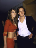 Actors Elizabeth Hurley and Hugh Grant at Party at Mondrian Preceding Golden Globe Awards Premium Photographic Print by Dave Allocca