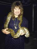 Rock Musician Ozzy Osbourne with a Snake around His Neck Premium Photographic Print
