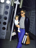 Actor Harrison Ford, Wearing Sunglasses, Holding Son Malcolm Premium Photographic Print